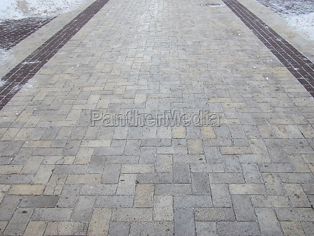 a tiled path in a snow