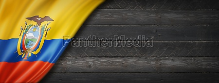 ecuadorian flag on black wood wall
