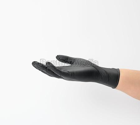 female hand in a black latex