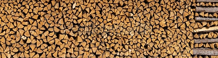 panoramic stack of brown firewood
