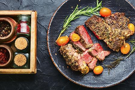 succulent veal steak with kumquat close