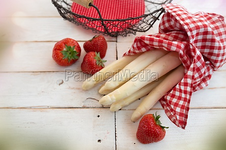 asparagus and strawberries with basket