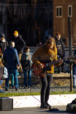 street musician playing guitar in rome