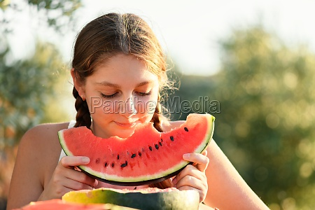 happy young woman enjoing and eating