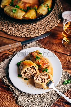 two cabbage rolls stuffed with minced