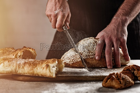 baker with bread just out of