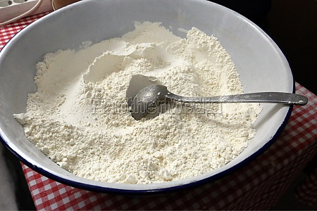 bowl of flour and spoon