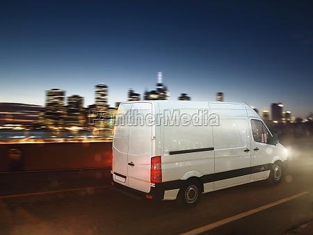 fast van on a city road
