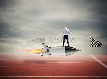winner businessman over a fast rocket