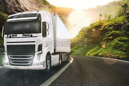 white truck moving on the road