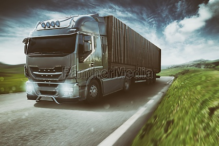 grey truck moving fast on the