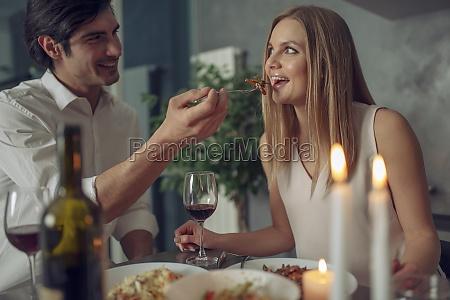 couple enjoying a romantic dinner by