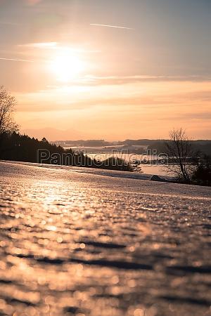 sunset scenery in winter lake snowy