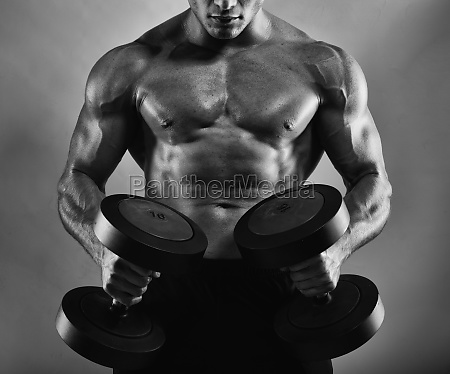 athletic man training biceps