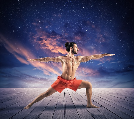 yoga under the sky with stars