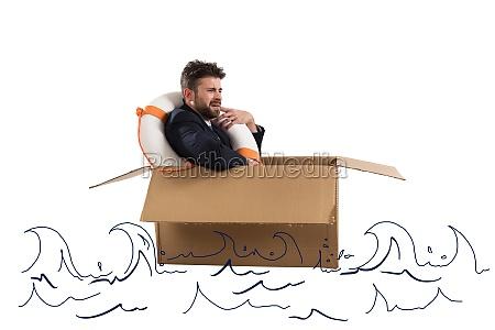 afraid businessman with cardboard in the