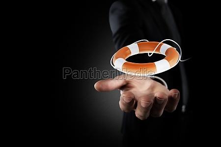businessman that hold a lifebelt concept