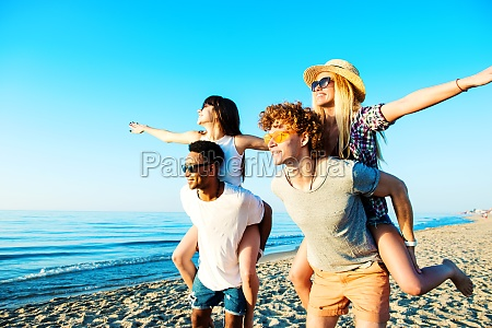 happy smiling couples playing at the