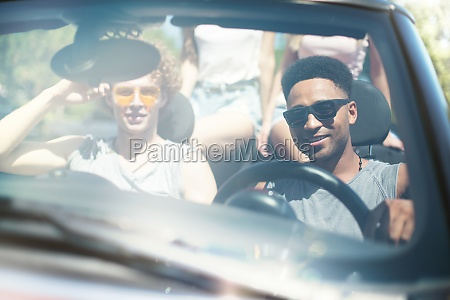 young friends in cabriolet car ready