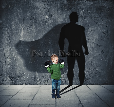 young child with his shadow of