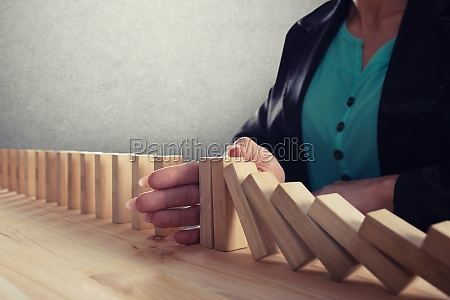 businesswoman stops a chain fall like