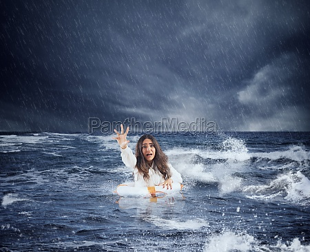 businesswoman in the ocean with lifebelt