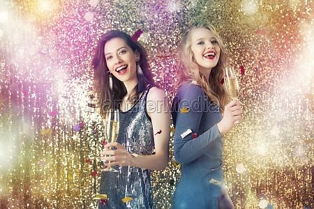 girls drink sparkling wine to celebrate