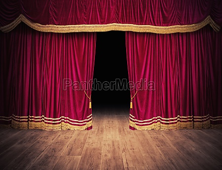 the red curtains are opening for