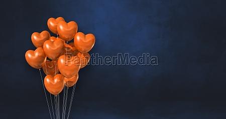 orange heart shape balloons bunch on