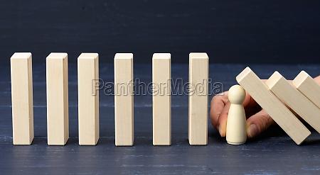 womans hand between the wooden blocks