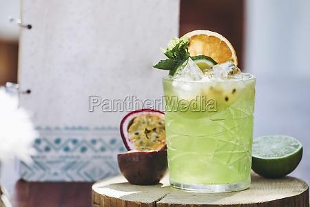 glass of cold green alcohol mojito