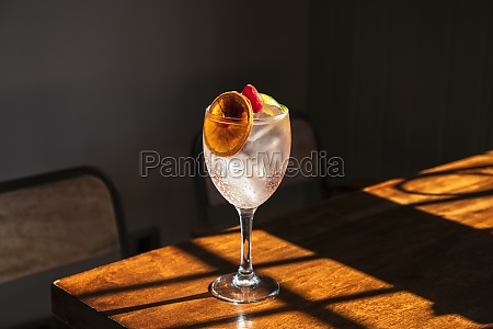 crystal goblet with cold alcohol cocktail