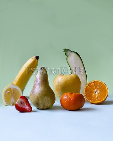 various fruits partially cut in halves