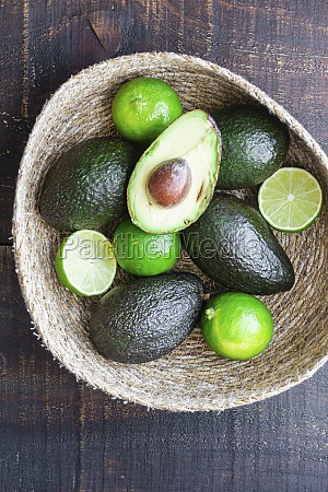 bowl with fresh avocados and lime