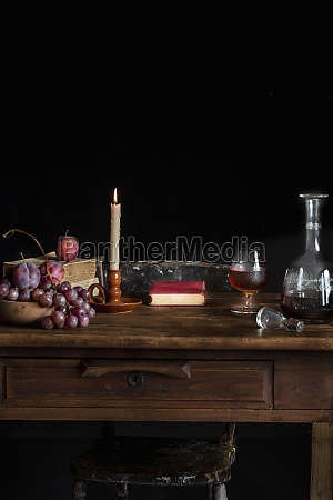 wooden table with glass of cognac