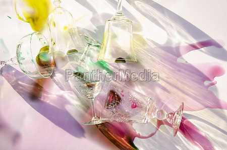 glasses and spilled colorful liquids