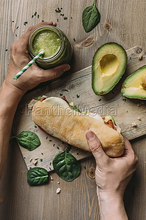 hand holding a panini with turkey
