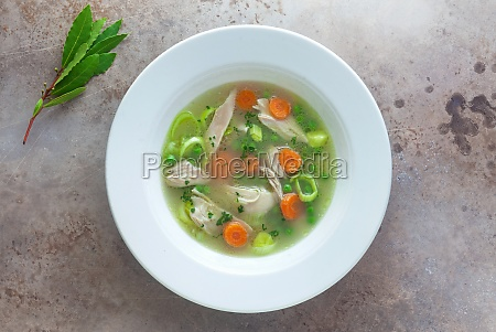 a bowl of chicken soup with