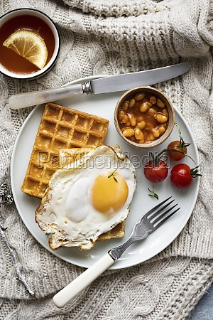 breakfast with fried egg baked beans