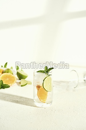 glass of water with lime orange