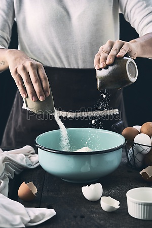 woman adding sugar and flour in