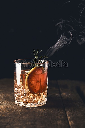 negroni cocktail with orange slice and