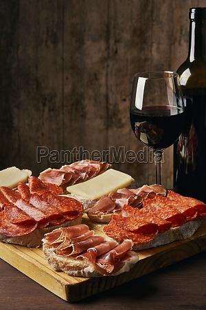 pieces of bread with ham salami