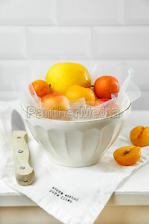 fresh yellow plums in a bowl