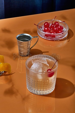 bourbon cocktail with cherry and ice