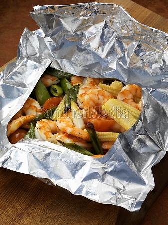 prawns and vegetables steamed in foil