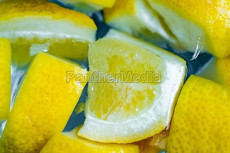 water with lemon slice fresh lemon