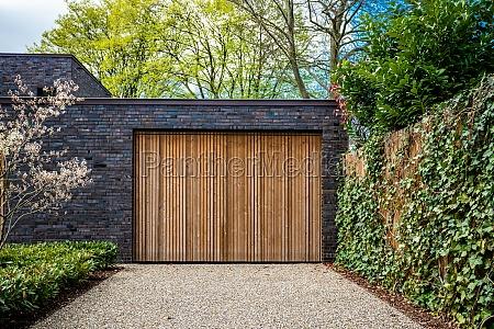 wide garage door and concrete driveway
