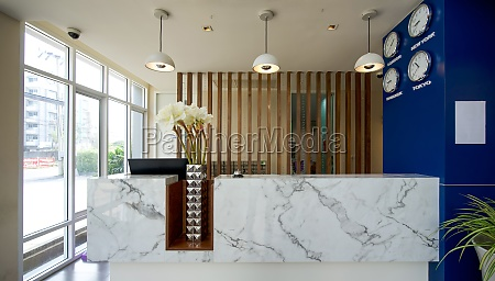 a long white marble reception counter