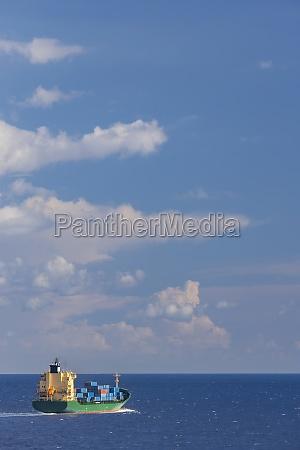cargo ship nearby capo peloro lighthouse